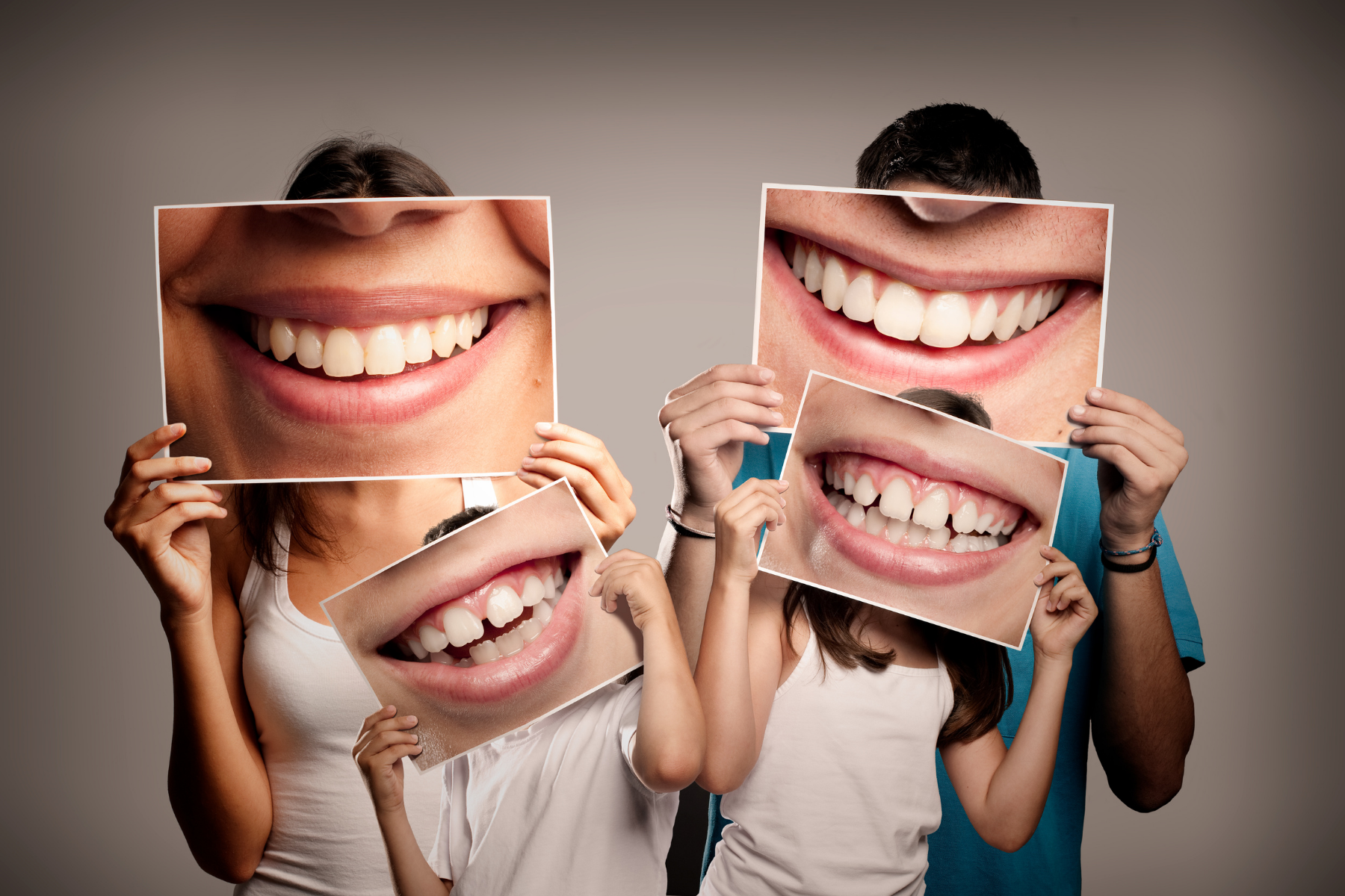 family holding pictures of smiles