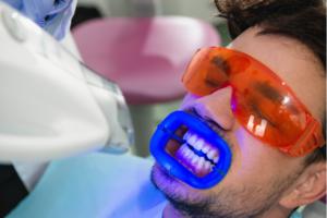 Man getting his teeth whitened