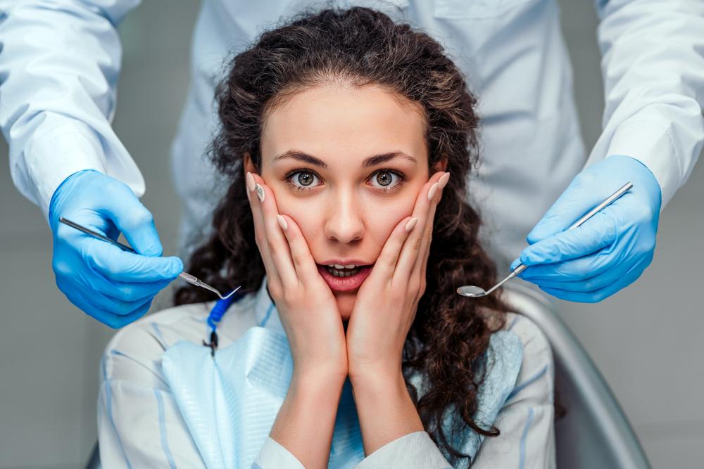 woman cradling face in shock